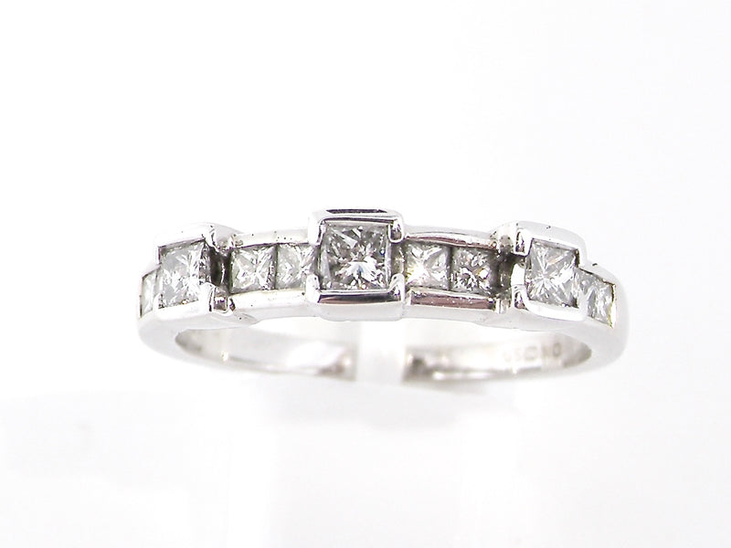 An 18 carat white gold diamond eternity ring