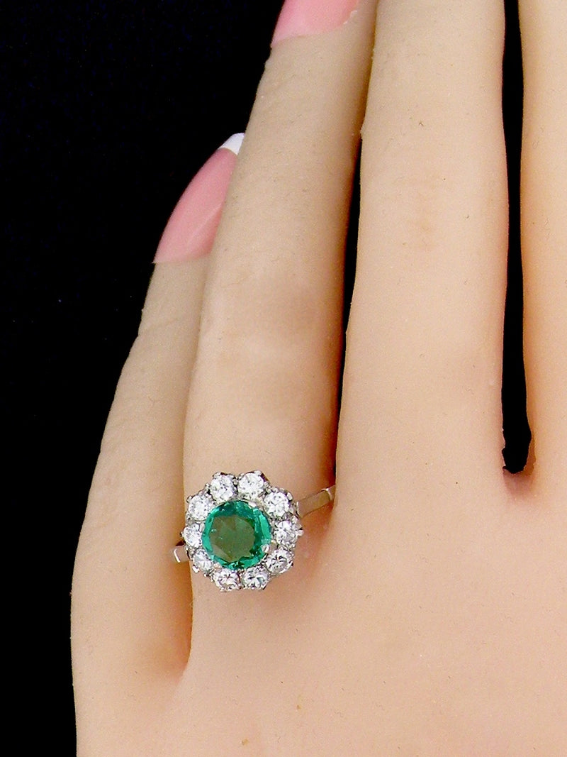 A fine emerald and diamond vintage cluster ring