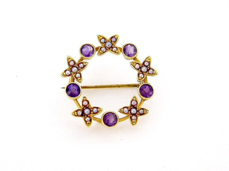 An antique  15 carat gold  pearl and amethyst brooch