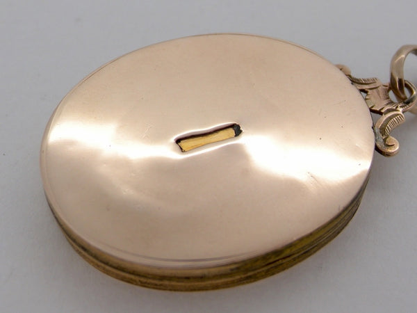 A large oval gold locket