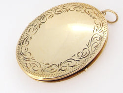 A large 9 carat gold locket
