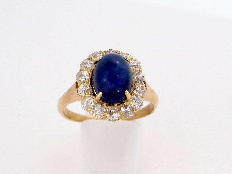 A vintage cabochon and diamond cluster ring