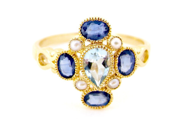 An Art Deco style aquamarine and sapphire ring