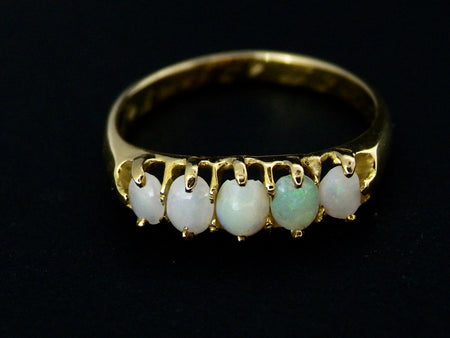 An 18 carat gold Victorian opal dress ring