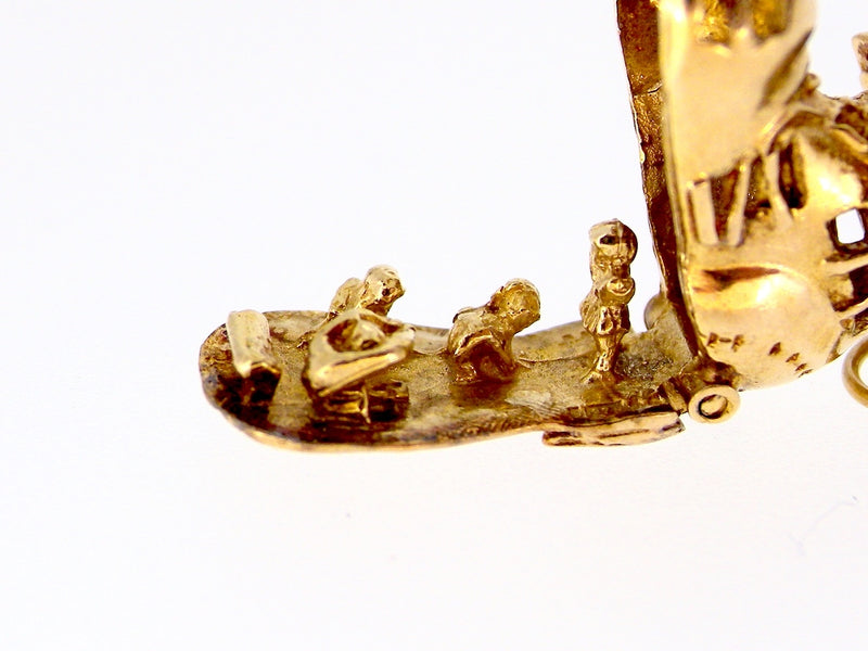 A 9 carat gold woman in shoe charm