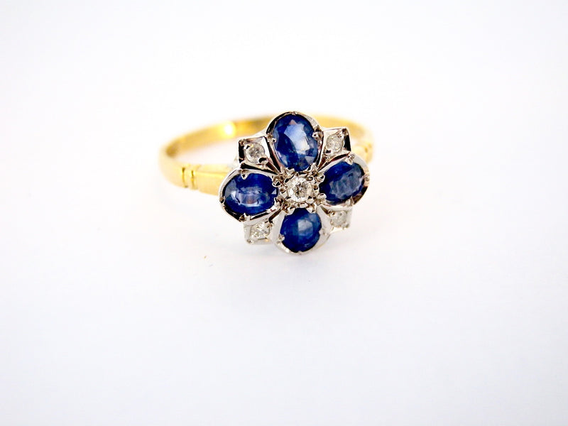 A 9 carat gold sapphire and diamond cluster ring