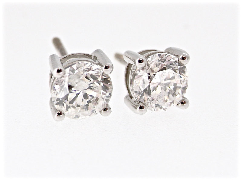 A fine pair of 2 carat diamond stud earrings