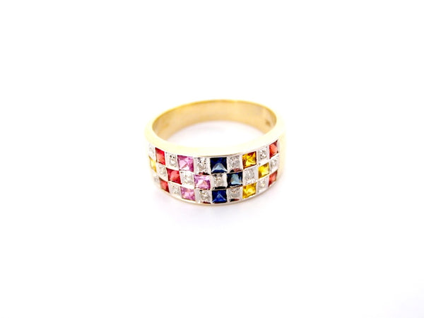 A multi gemstone half hoop dress ring
