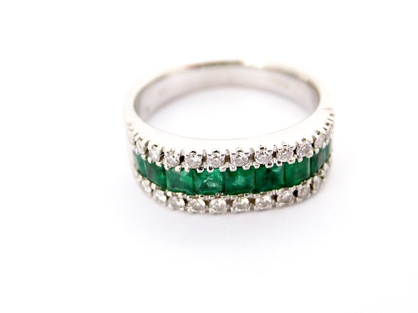 An 18 carat white gold emerald and diamond eternity ring