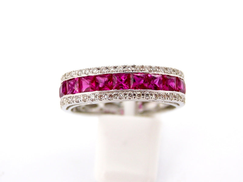 A white gold ruby and diamond half hoop ring