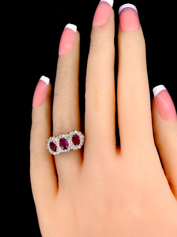 An antique ruby and diamond multi cluster gem ring