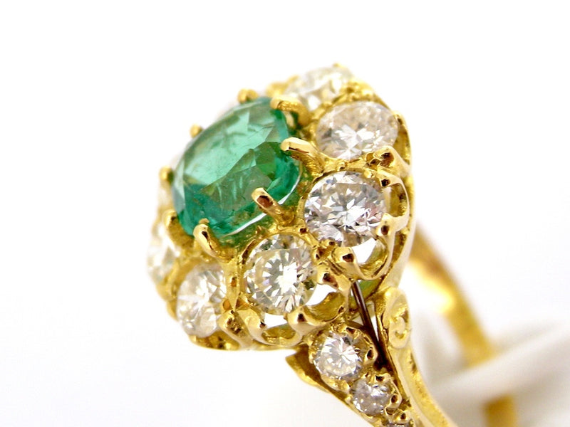 A fine 18ct gold emerald and diamond cluster ring-SAVE ALMOST £1500!