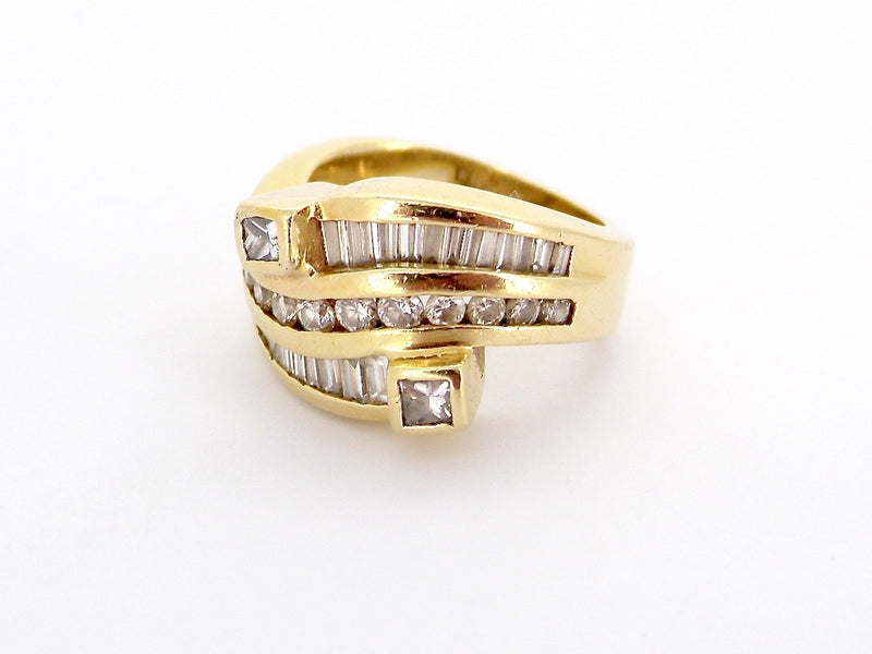 A three row mixed cut diamond ring