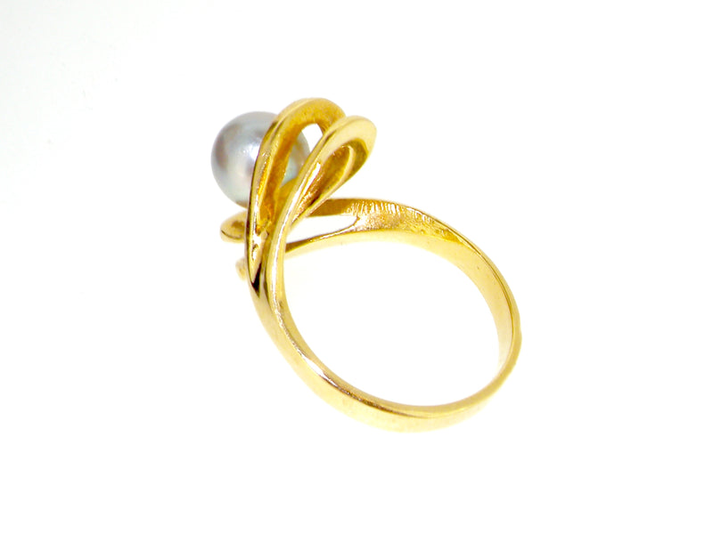 A 14 carat gold pearl dress ring