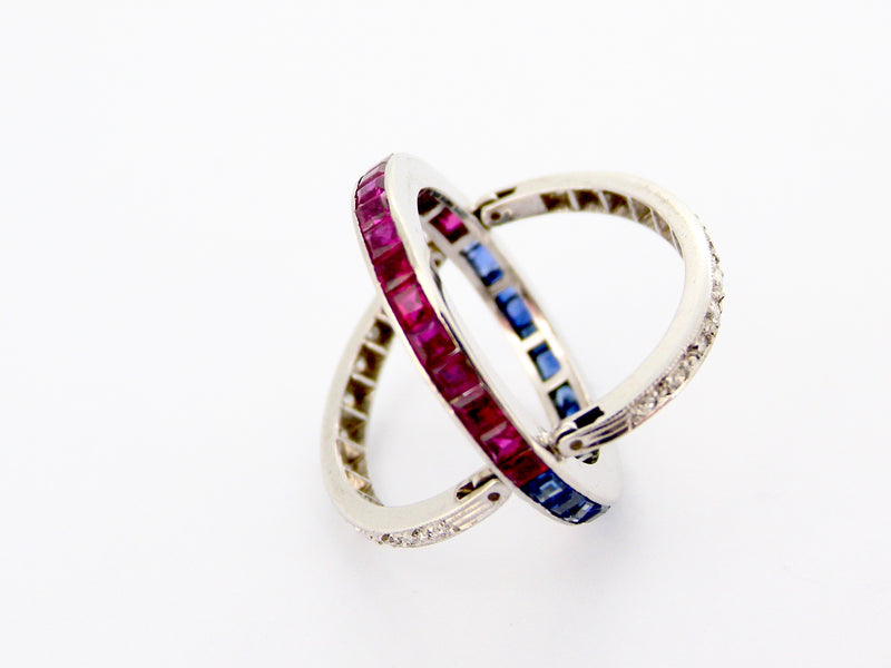 A platinum 'Night and Day' ring with sapphires, rubies and diamonds