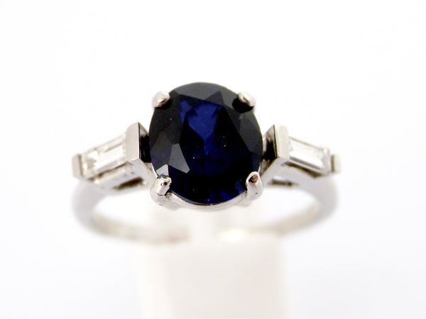 A white gold sapphire and diamond ring
