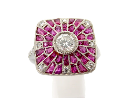 A platinum Art Deco ruby and diamond cluster ring