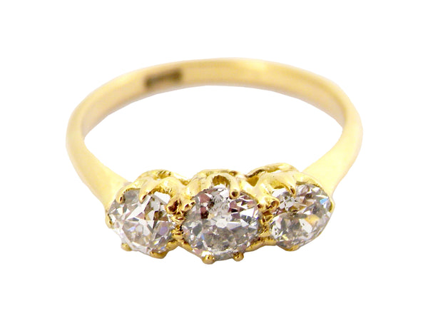A traditional 18 carat gold three stone diamond ring