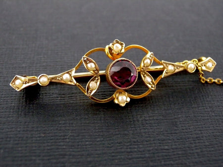 An antique garnet and pearl bar brooch