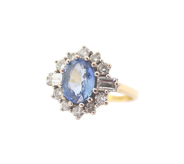 An 18 carat gold sapphire and diamond ring *sold* *MRS PRESTON PLEASE CONTACT US ASAP*