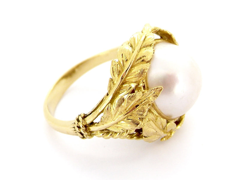 An 18 carat gold pearl dress ring