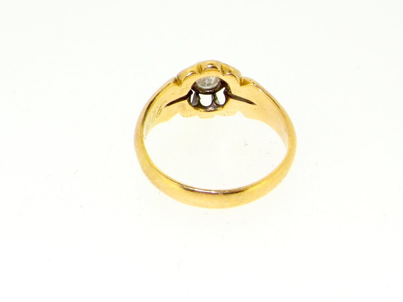 An 18 carat gold gypsy style diamond ring