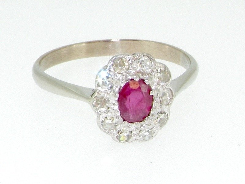 A platinum ruby and diamond cluster ring