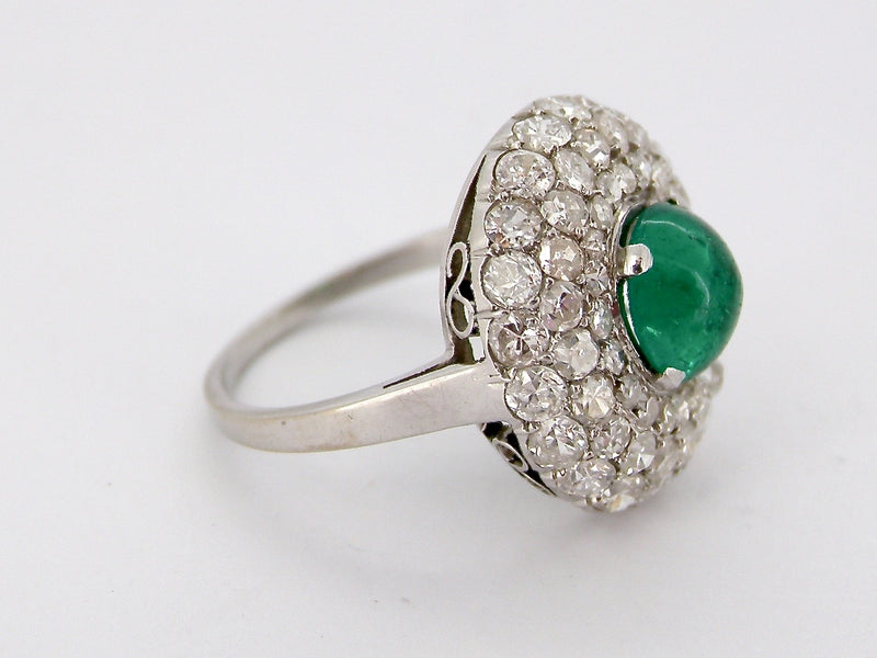 A fine emerald and diamond cluster ring