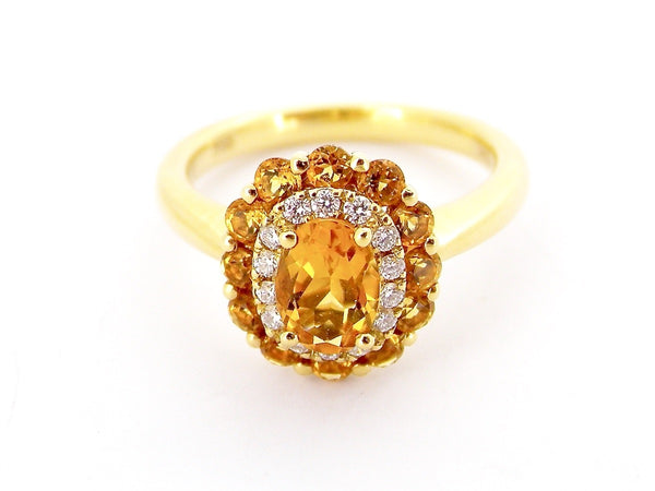 An 18 carat gold citrine cluster dress ring