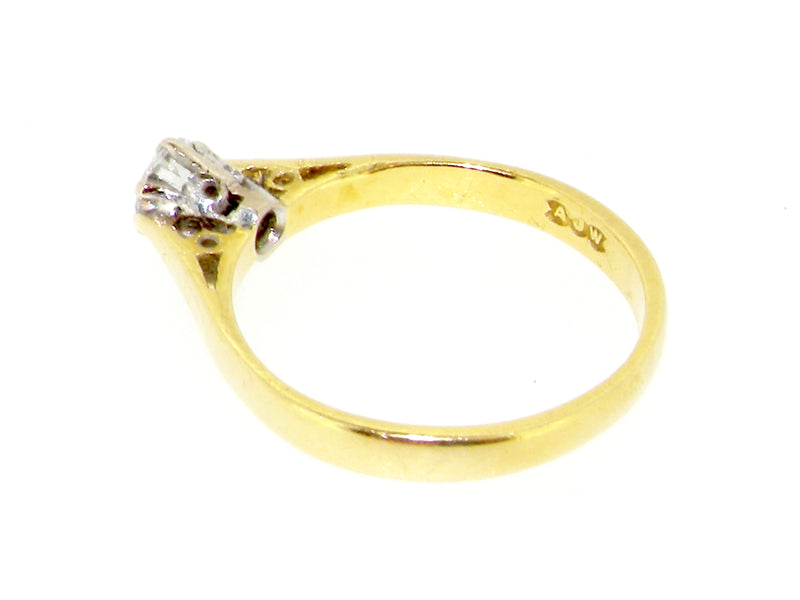 An 18 carat gold diamond solitaire ring- .25 carats
