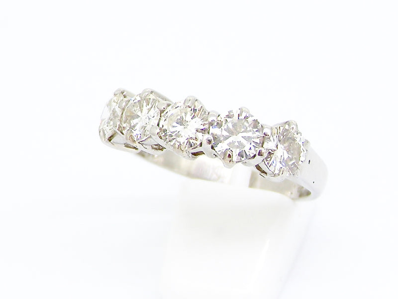 A 1.5 carat+ five stone diamond ring