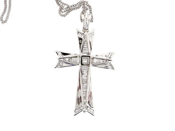 A 14 carat white gold diamond set cross