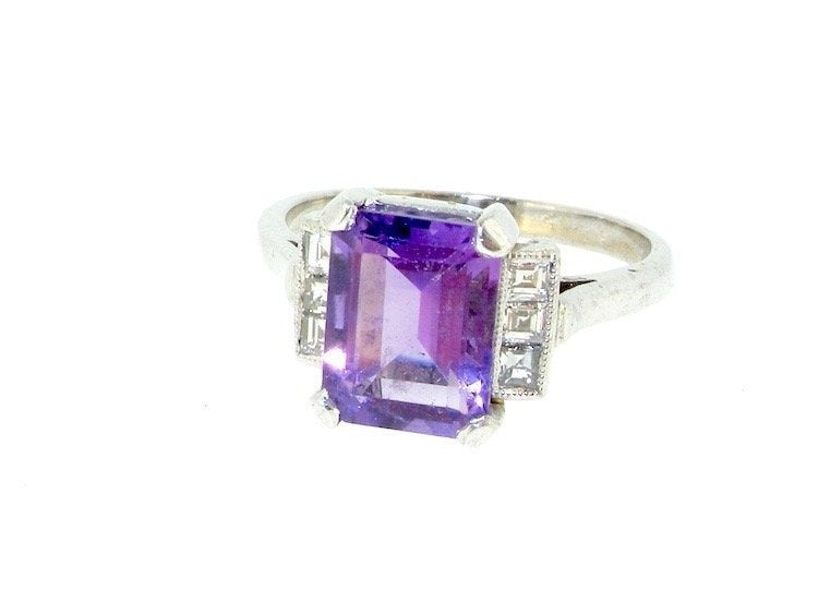 An 18 carat gold amethyst and diamond ring