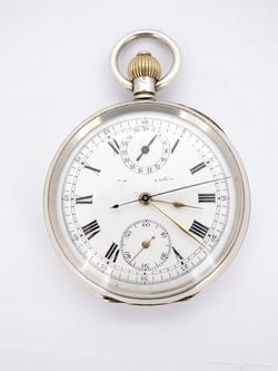 A silver chronograph pocket watch