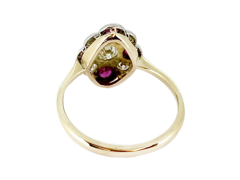 An Edwardian ruby and diamond cluster ring