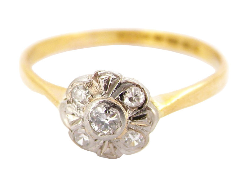 An 22 carat gold  diamond daisy cluster  ring