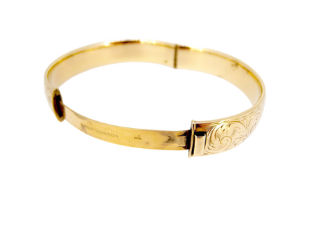 A traditional hinged 9 carat gold bangle