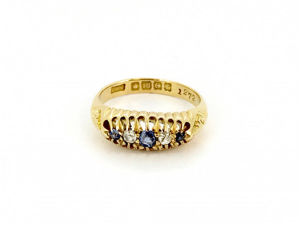 An 18 carat gold antique sapphire and diamond ring