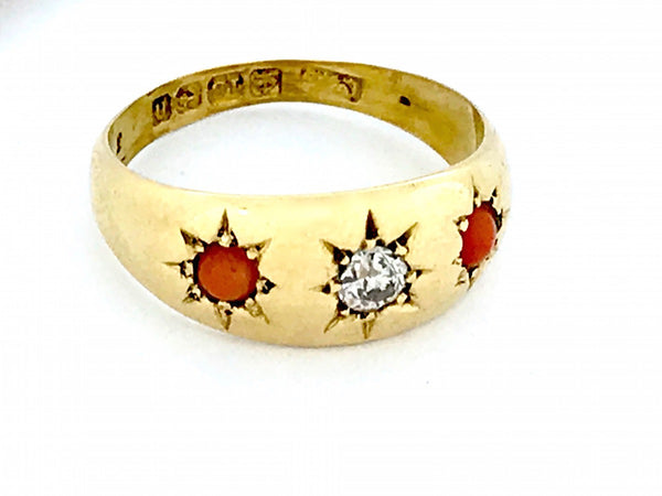 An antique 18 carat gold coral and diamond ring