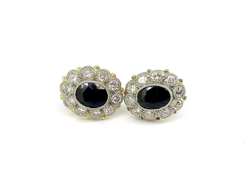 A fine pair of sapphire and diamond cluster earrings