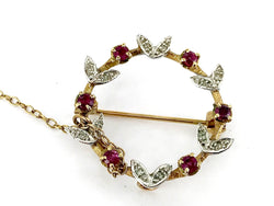 A ruby and diamond circlet brooch