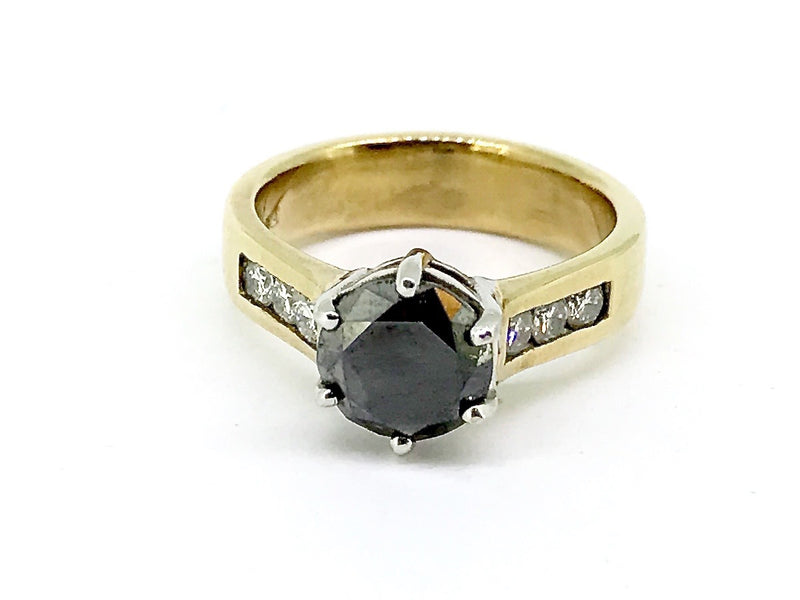 A solitaire black diamond gem ring
