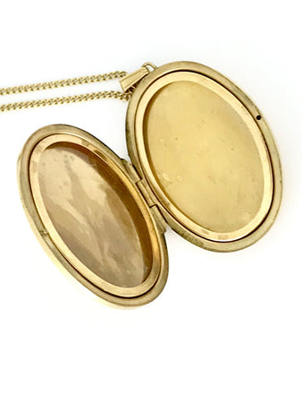 A large 9 carat gold engraved locket