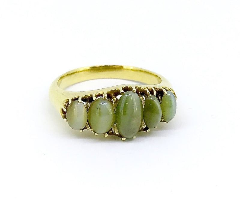 An antique five stone cats eye chrysoberyl gem ring