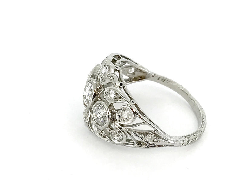A fine platinum Edwardian diamond cluster ring