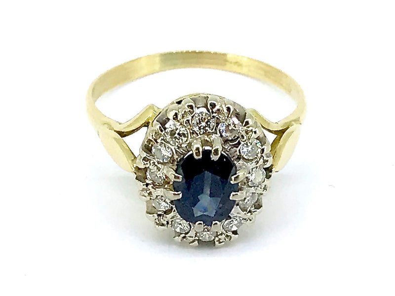 A traditional diamond and sapphire cluster ring