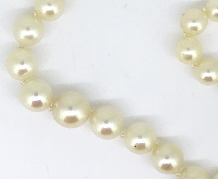 A fine row of cultured pearls with a diamond clasp