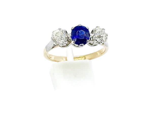 A three stone sapphire and diamond ring