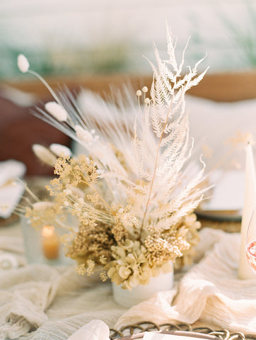 dried flower wedding centerpiece in white fern and natural tan flowers