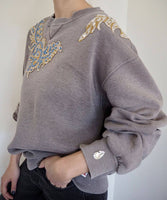 Cozy vintage sweatshirt adorned by Jen Wonders